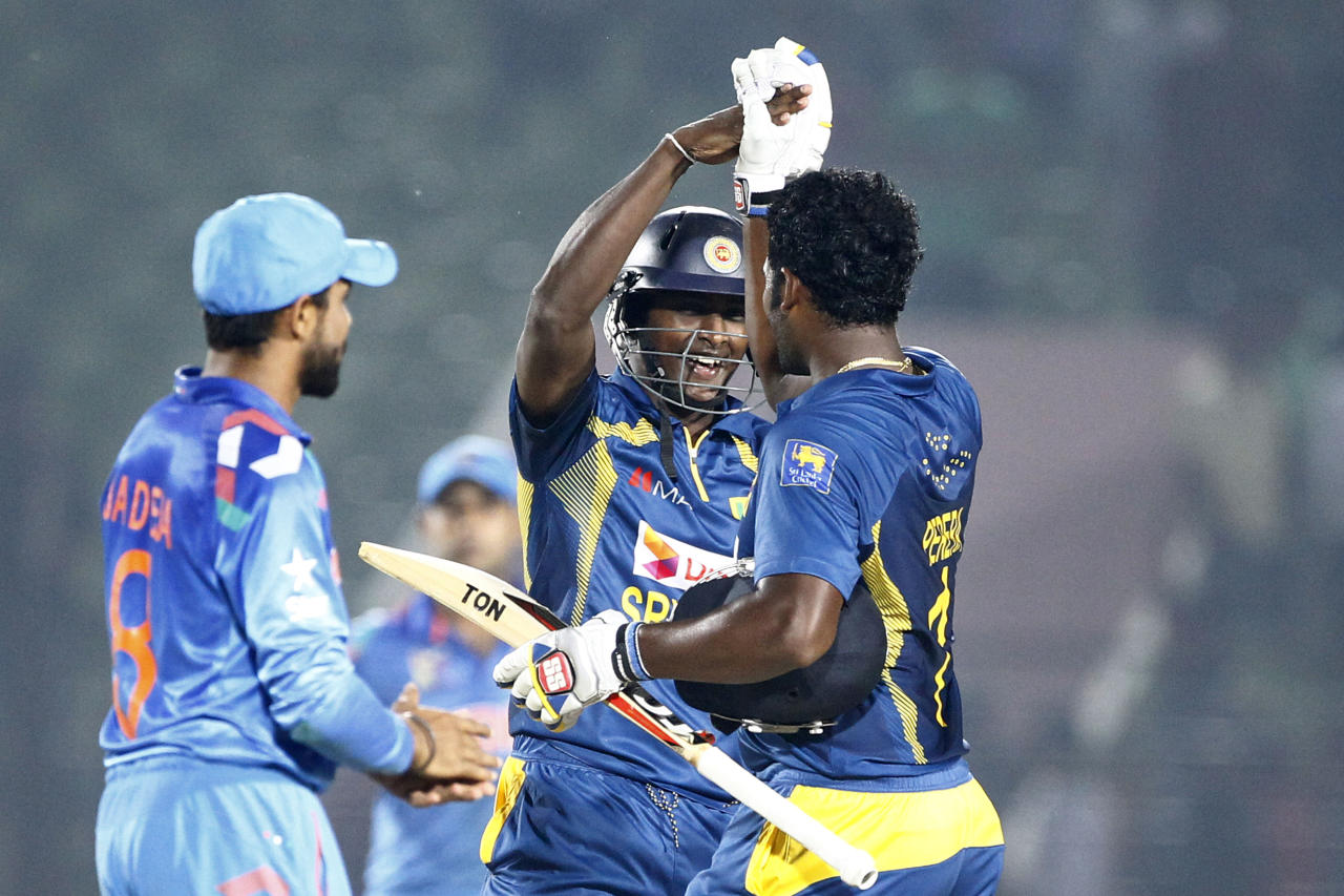 Sri Lanka's Ajantha Mendis, center, celebrates with Thisara Perera after wining the Asia Cup one-day international cricket tournament mach against India in Fatullah, near Dhaka, Bangladesh, Friday, Feb. 28, 2014. (AP Photo/A.M. Ahad)