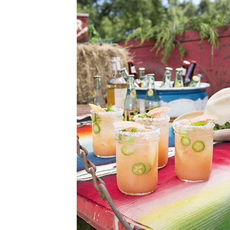 """<p>This cocktail made with grapefruit juice and jalapeno-infused tequila is the perfect blend of sweet and spicy.</p><p><em>Get the recipe from <a href=""""https://www.countryliving.com/food-drinks/recipes/a45485/grapefruit-ranch-water-recipe/"""" rel=""""nofollow noopener"""" target=""""_blank"""" data-ylk=""""slk:Country Living"""" class=""""link rapid-noclick-resp"""">Country Living</a>.</em></p>"""