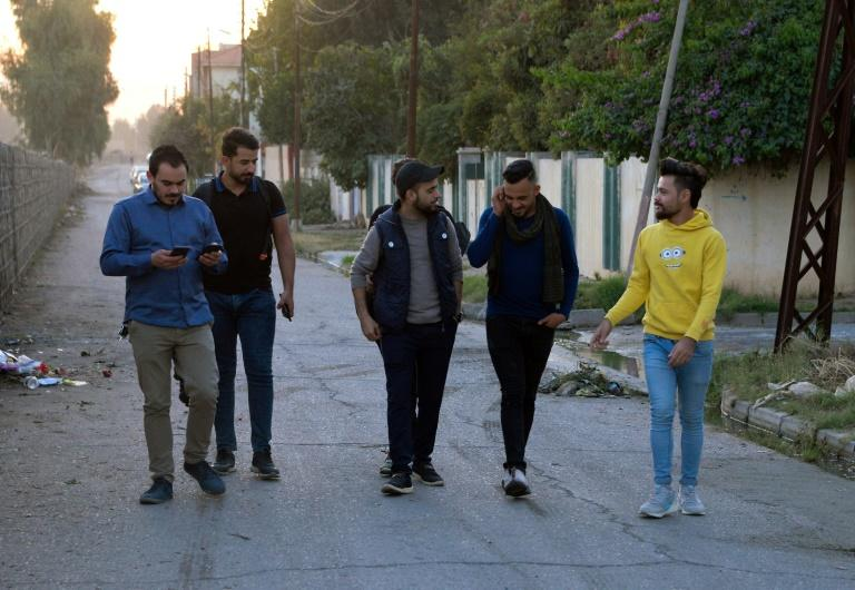 Young men in Iraq's second city Mosul ahead of performing a local adaption of famous Italian resistance song 'Bella Ciao'