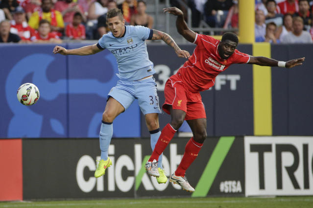 Manchester City forward Stevan Jovetic (35) challenges for the ball against Liverpool defender Kolo Toure (4) in the first half of a Guinness International Champions Cup soccer tournament match, Wednesday, July 30, 2014, at Yankee Stadium in New York. (AP Photo/Julie Jacobson)