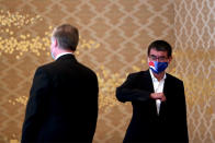 U.S. Deputy Secretary of State Stephen Biegun, left, the top U.S. official on North Korea, and Japan's Defense Minister Taro Kono, wearing face masks, greet each other prior to a bilateral meeting in Tokyo Friday, July 10, 2020. (Behrouz Mehri/Pool Photo via AP)