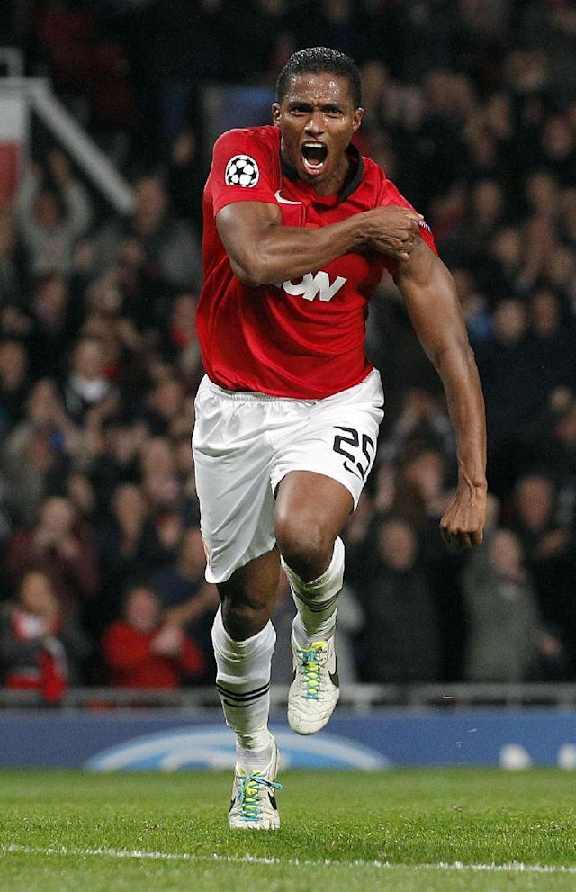 Manchester United's Antonio Valencia celebrates after he scored the fourth goal of the game for his side during their Champions League Group A soccer match at Old Trafford in Manchester, England, Tuesday Sept 17, 2013. (AP Photo/Jon Super)