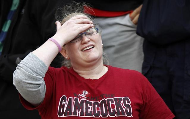 A South Carolina fan reacts to their 23-21 loss to Tennessee in an NCAA college football game on Saturday, Oct. 19, 2013 in Knoxville, Tenn. (AP Photo/Wade Payne)