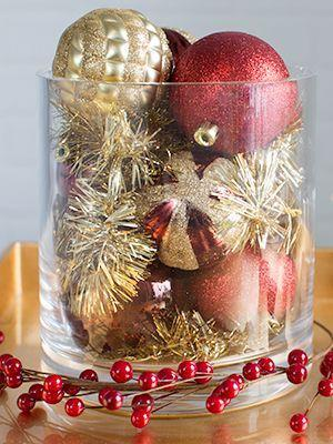 """<p>If there's no more room on the tree, pour <a href=""""https://www.goodhousekeeping.com/holidays/christmas-ideas/g393/homemade-christmas-ornaments/"""" rel=""""nofollow noopener"""" target=""""_blank"""" data-ylk=""""slk:ornaments"""" class=""""link rapid-noclick-resp"""">ornaments</a> and tinsel in a clear vase. The glittery contents will bounce candlelight all around the room. </p><p><a class=""""link rapid-noclick-resp"""" href=""""https://www.amazon.com/KI-Store-Shatterproof-Decorations-Decoration/dp/B016MKL27G?tag=syn-yahoo-20&ascsubtag=%5Bartid%7C10055.g.2196%5Bsrc%7Cyahoo-us"""" rel=""""nofollow noopener"""" target=""""_blank"""" data-ylk=""""slk:SHOP ORNAMENTS"""">SHOP ORNAMENTS</a></p>"""
