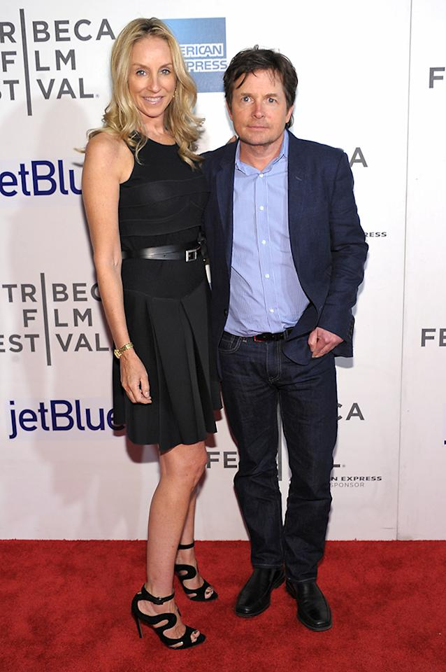 """NEW YORK, NY - APRIL 20:  Tracy Pollan and Michael J. Fox attend the """"Trust Me"""" world premiere during the 2013 Tribeca Film Festival on April 20, 2013 in New York City.  (Photo by Michael Loccisano/Getty Images for Tribeca Film Festival)"""
