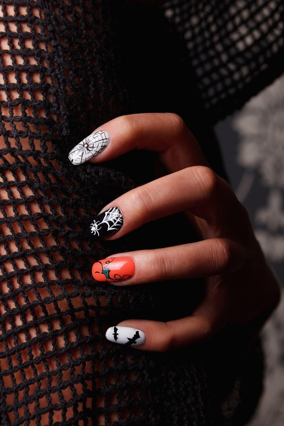 """<p>Spin a stringy spiderweb on your fingers with the help of some super easy nail decals that come in different sizes—and include creepy crawly spiders! </p><p><a class=""""link rapid-noclick-resp"""" href=""""https://go.redirectingat.com?id=74968X1596630&url=https%3A%2F%2Fwww.etsy.com%2Flisting%2F540930274%2Fhalloween-nail-art-white-spiders-spider&sref=https%3A%2F%2Fwww.oprahdaily.com%2Fbeauty%2Fskin-makeup%2Fg33239588%2Fhalloween-nail-ideas%2F"""" rel=""""nofollow noopener"""" target=""""_blank"""" data-ylk=""""slk:SHOP SPIDERWEB DECAL"""">SHOP SPIDERWEB DECAL </a></p>"""