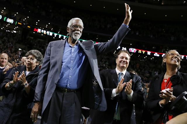 Boston Celtics great Bill Russell waves to the crowd during a tribute in his honor in the second quarter of an NBA basketball game between the Celtics and the Milwaukee Bucks in Boston, Friday, Nov. 1, 2013. (AP Photo/Michael Dwyer)