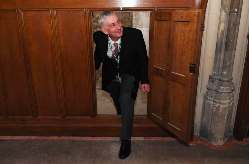 Speaker of the House of Commons Lindsay Hoyle being shown a secret doorway that has been rediscovered in the House of Commons. (PA)