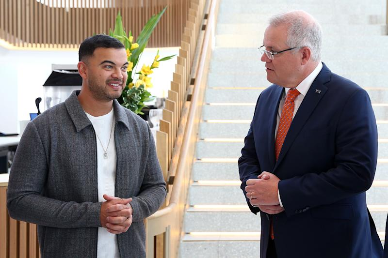 Singer Guy Sebastian and Prime Minister Scott Morrison speak during a tour of the Sydney Coliseum Theatre at West HQ on June 25, 2020 in Sydney, Australia. The federal government has announced a $250 million support package for the arts and cultural sectors to assist in economic recovery from the COVID-19 pandemic. The funding package includes $90 million in government-backed concessional loans to fund new productions and a $75m grant program that will provide capital to help Australian production and events businesses put on new festivals, concerts, tours and other events as social distancing restrictions ease. (Photo: Matt Blyth via Getty Images)