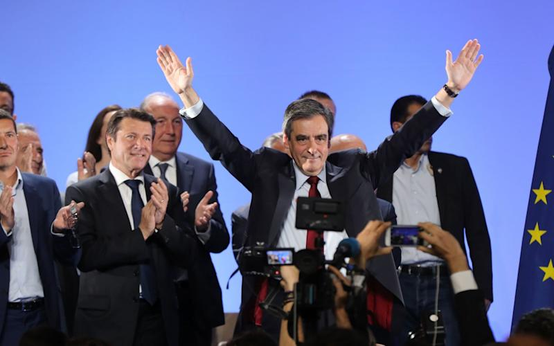 French presidential election candidate for the right-wing Les Republicains (LR) party Francois Fillon (C) gestures as he arrives for a campaign meeting in Nice - Credit: VALERY HACHE/AFP