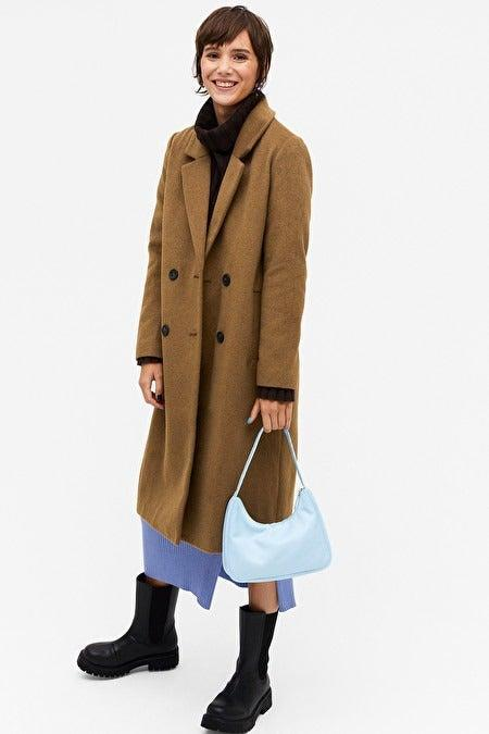 """<br><br><strong>Monki</strong> Classic double-breasted coat, $, available at <a href=""""https://www.monki.com/en_gbp/clothing/coats-jackets/coats/product.classic-double-breasted-coat-beige.0631964019.html"""" rel=""""nofollow noopener"""" target=""""_blank"""" data-ylk=""""slk:Monki"""" class=""""link rapid-noclick-resp"""">Monki</a>"""