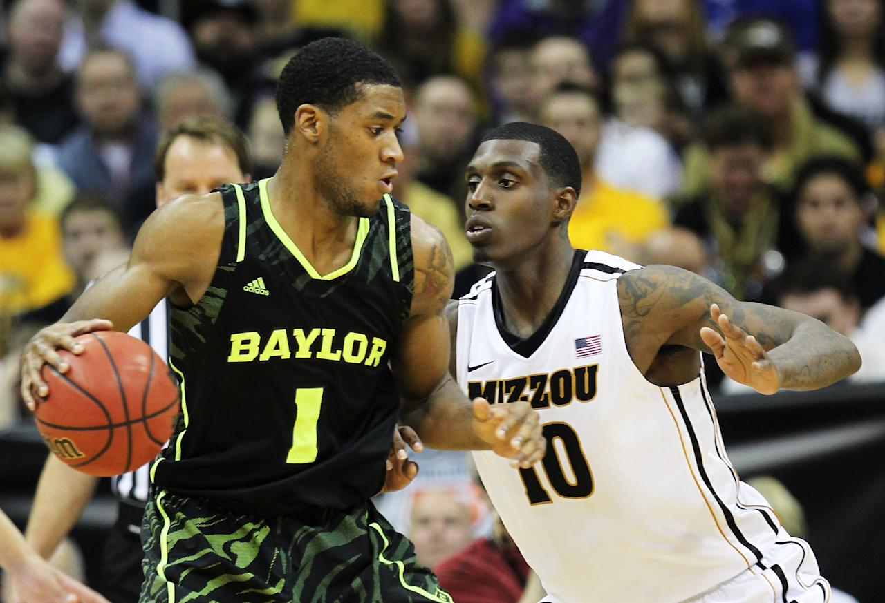 KANSAS CITY, MO - MARCH 10:  Perry Jones III #1 of the Baylor Bears drives against Ricardo Ratliffe #10 of the Missouri Tigers in the first half during the championship game of the 2012 Big 12 Men's Basketball Tournament at Sprint Center on March 10, 2012 in Kansas City, Missouri.  (Photo by Jamie Squire/Getty Images)