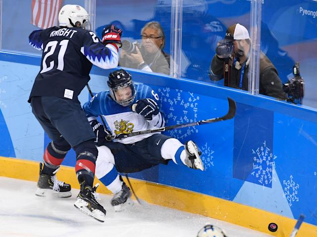<p>Hilary Knight (21) checks Jenni Hiirikoski (6) during the women's ice hockey semifinal game between the United States and Finland during the Pyeongchang 2018 Winter Olympic Games at the Gangneung Hockey Centre. February 19, 2018 (Photo by Hyoung Chang/The Denver Post via Getty Images) </p>