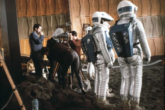 Stanley Kubrick (far left) directing <em>2001: A Space Odyssey</em>. (Warner Bros. c/o Everett Collection)