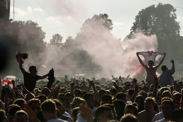 England soccer fans celebrates first goal as they watch a live broadcast on a big screen of the semifinal match between Croatia and England at the 2018 soccer World Cup, in Hyde Park, London, Wednesday, July 11, 2018. (AP Photo/Matt Dunham)
