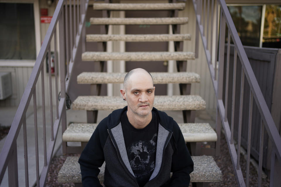 Bryan Blew poses for a portrait at his apartment Friday, Jan. 8, 2021, in Las Vegas. Blew, a bass player in Las Vegas, had been playing in three different bands in casinos and other venues before the coronavirus shut down live music. (AP Photo/John Locher)