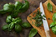 <p>Your basil is best left at room temperature with the stems submerged in water. This goes for other herbs as well.</p>