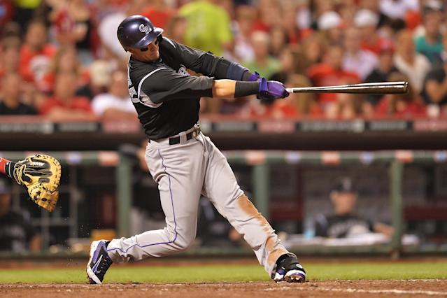 CINCINNATI, OH - MAY 10: Troy Tulowitzki #2 of the Colorado Rockies connects for a solo home run in the sixth inning at Great American Ball Park on May 10, 2014 in Cincinnati, Ohio. Colorado defeated Cincinnati 11-2. (Photo by Jamie Sabau/Getty Images)