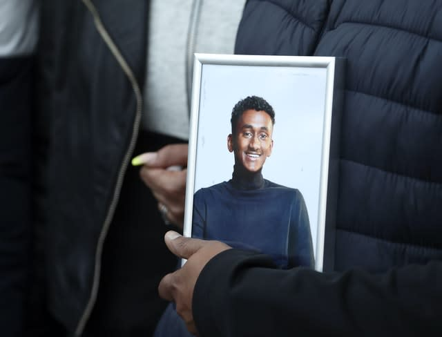 Chandima Daniel, father of Tashan Daniel, holds a photograph of his son