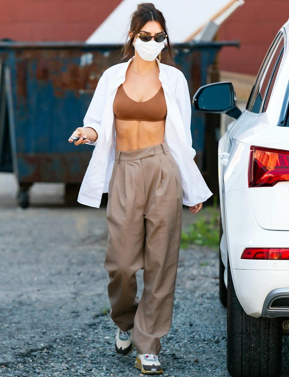 <p>Emily Ratajkowski shows off her toned abs while out and about in Brooklyn on Tuesday. </p>