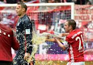 Bayern's captain Philipp Lahm (R) says the squad must raise their game to win one last title before Carlo Ancelotti takes over as head coach next season (AFP Photo/Christof Stache)