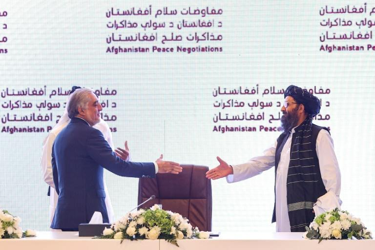 The head of Afghanistan's High Council for National Reconciliation Abdullah Abdullah (L) prepares to shake hands with the leader of the Taliban negotiating team Mullah Abdul Ghani Baradar Doha where two days of talks ended without significant progress