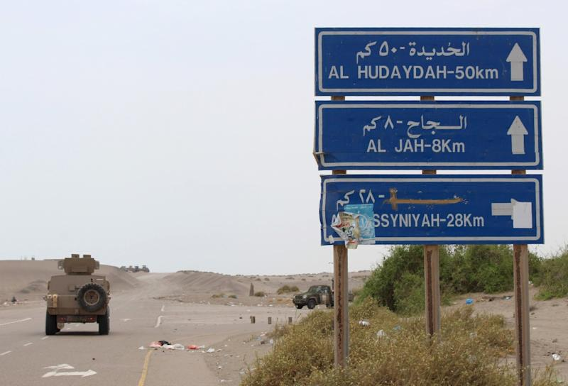 An armoured vehicle of the pro-government forces on June 2, 2018 moves on the main road towards the Yemeni port city of Hodeida, which the Iran-backed Huthi insurgents seized in 2014