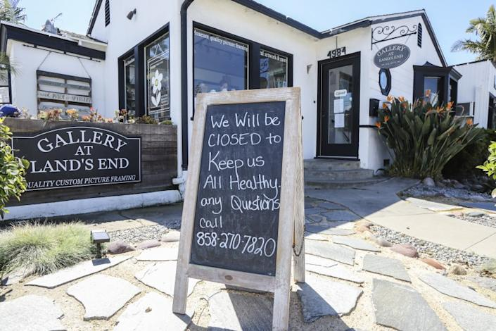 A Pacific Beach business at Loring and Cass Streets called Gallery at Land's End displays a coronavirus COVID-19 related closed sign outside their business on March 17, 2020 in San Diego, California.