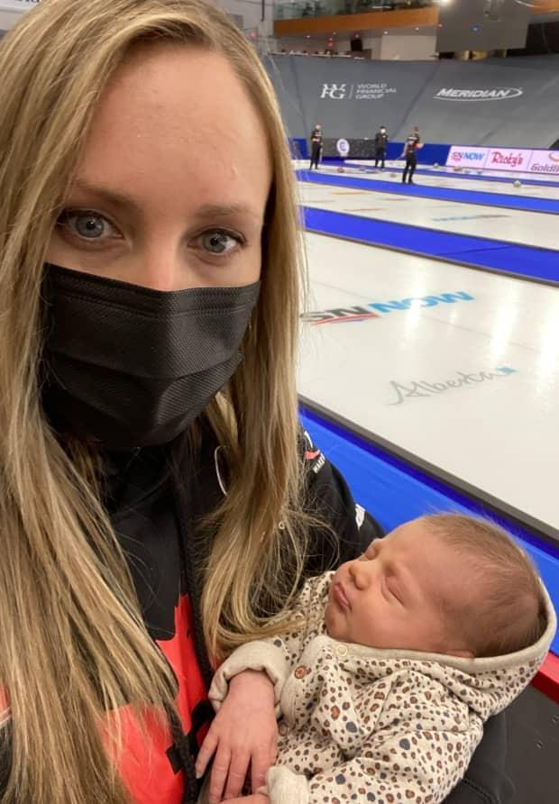 Rachel Homan holds daughter Bowyn inside Calgary's WinSport Arena during the women's Grand Slam of Curling.