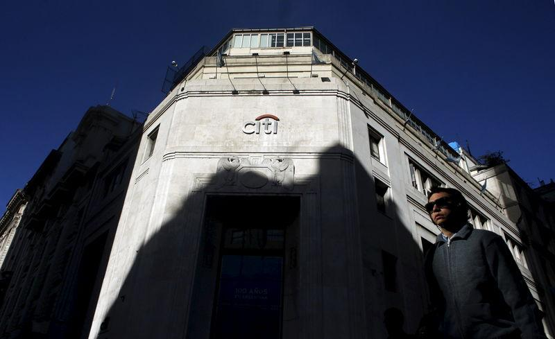 Woman walks past Citibank headquarters in Buenos Aires' financial district