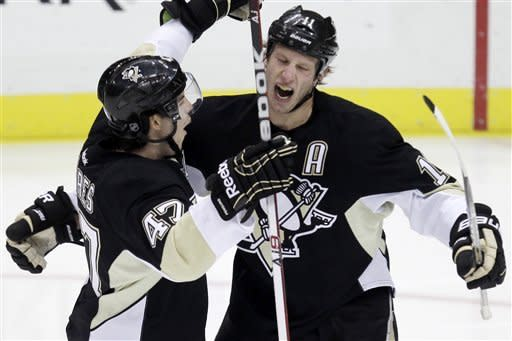 Pittsburgh Penguins' Jordan Staal, right, celebrates his first-period goal with Simon Despres (47) during an NHL hockey game against the Philadelphia Flyers in Pittsburgh, Thursday, Dec. 29, 2011. (AP Photo/Gene J. Puskar)