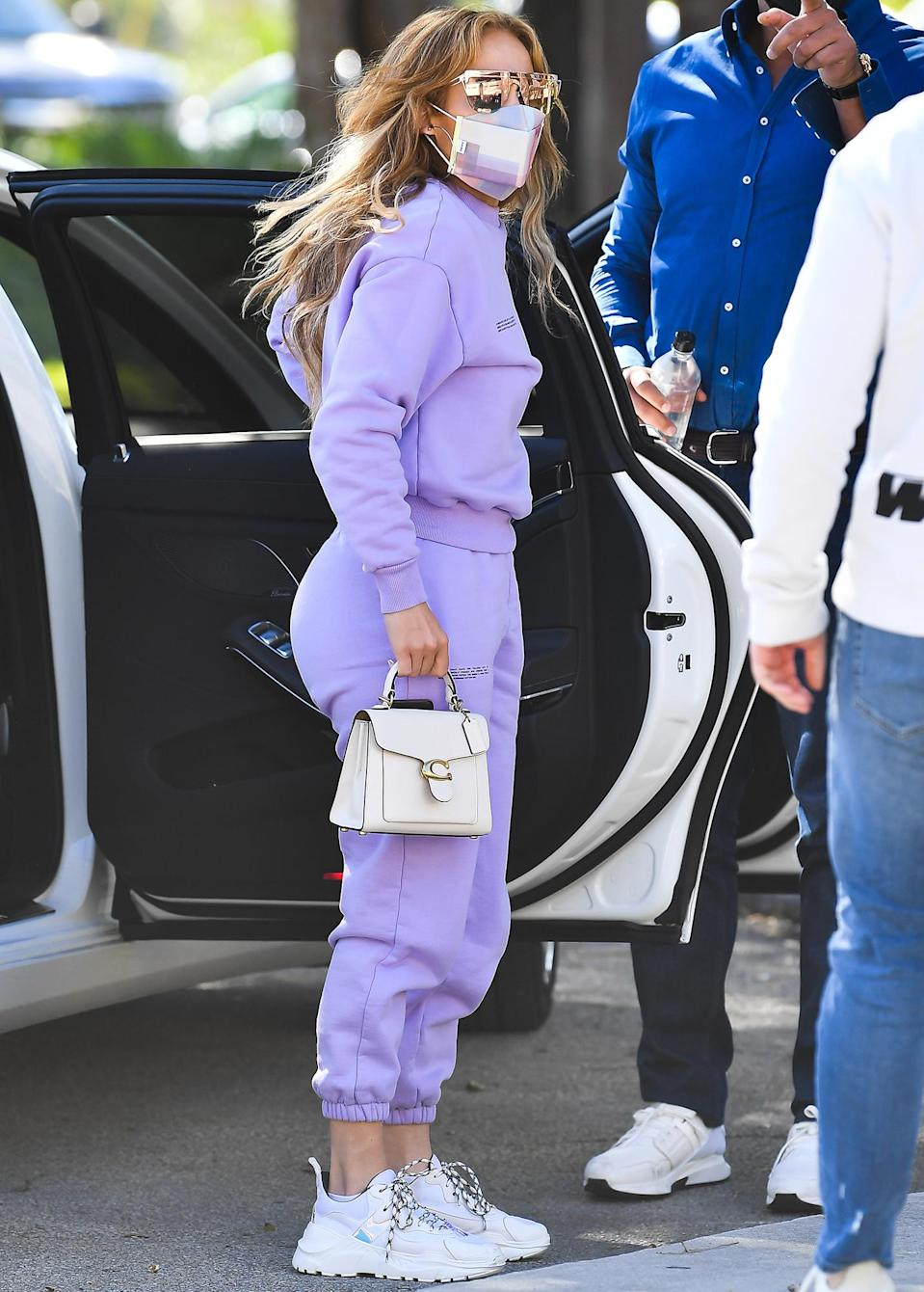 <p>Jennifer Lopez dresses in an all lilac sweatsuit to run errands in Miami on Monday.</p>