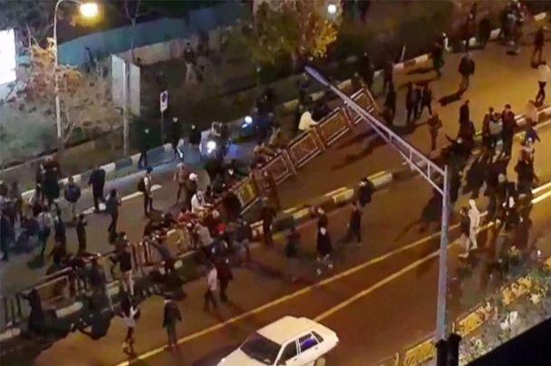 PHOTO: A group of people pull down at a fence in a street during protests in Tehran, Iran, Dec. 30, 2017, in an image taken from video released by Iran's Mehr News agency. (Mehr News via AFP/Getty Images)