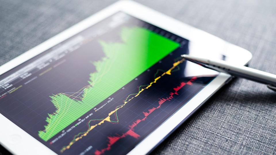 smart tablet ipad with stock charts on the screen