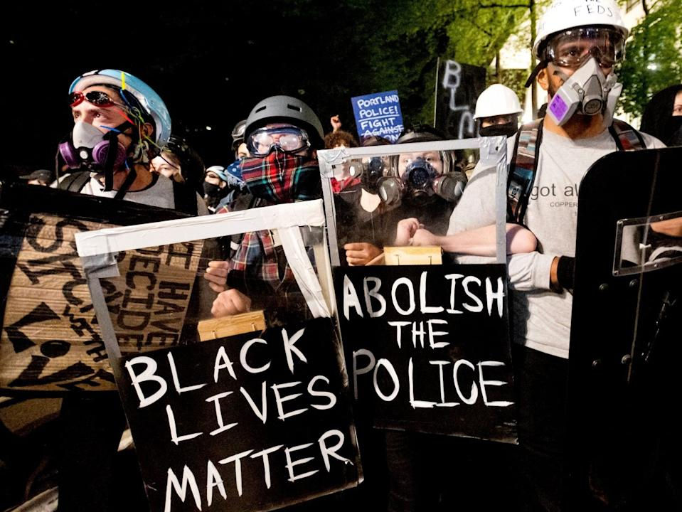 """Black Lives Matter protesters march through Portland, Ore. after rallying at the Mark O. Hatfield United States Courthouse on Sunday, Aug. 2, 2020. <p class=""""copyright"""">Noah Berger/AP</p>"""