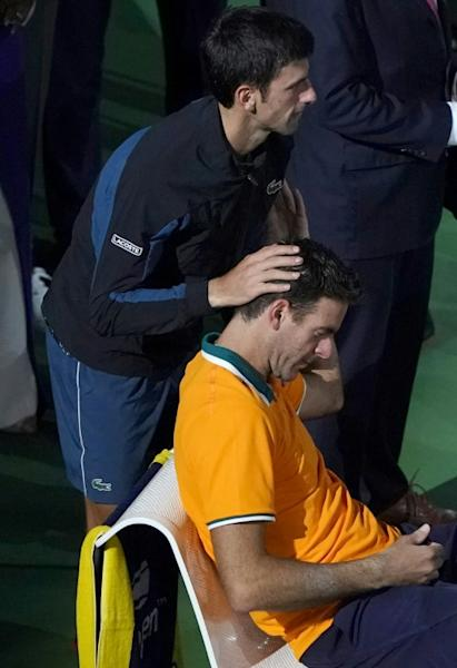 Novak Djokovic consoles Juan Martin del Potro after beating the Argentinian in the US Open final