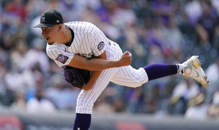 Colorado Rockies relief pitcher Robert Stephenson works against the Philadelphia Phillies in the eighth inning of a baseball game Sunday, April 25, 2021, in Denver. (AP Photo/David Zalubowski)