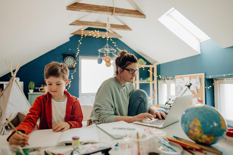 Mums are struggling to work and home school their children. (Getty Images)