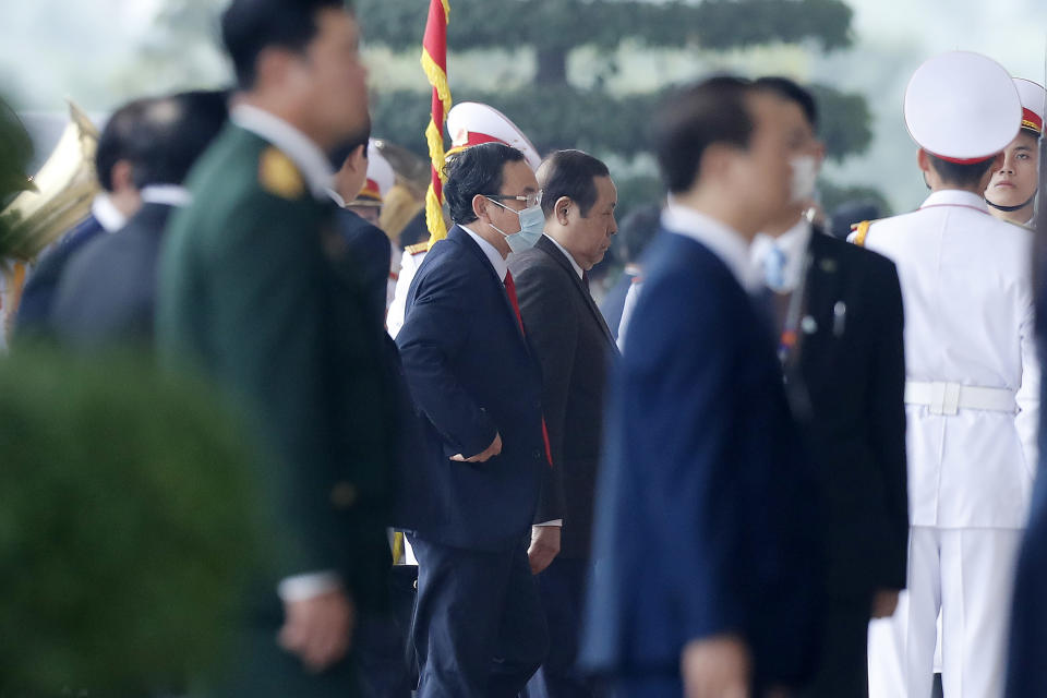 Nguyen Van Nen, center, secretary of the Ho Chi Minh City Party Committee arrives for the opening ceremony of the 13th National Congress of Vietnam's Communist Party (VCP), in Hanoi, Vietnam Tuesday, Jan. 26, 2021. (AP Photo/Minh Hoang)