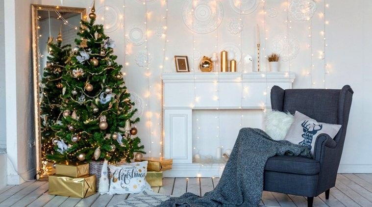 Modern design room in light colors decorated with Christmas tree and decorative elements