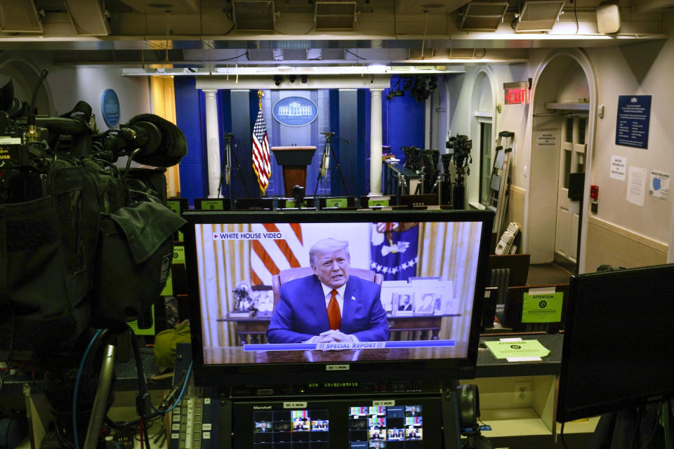 A video released by the White House, President Donald Trump shows a Twitter video on a television monitor in an empty press briefing room at the White House in Washington, after the U.S. House impeached him, Wednesday, Jan. 13, 2021. The pre-recorded video was being broadcast by Fox News. (AP Photo/Gerald Herbert )