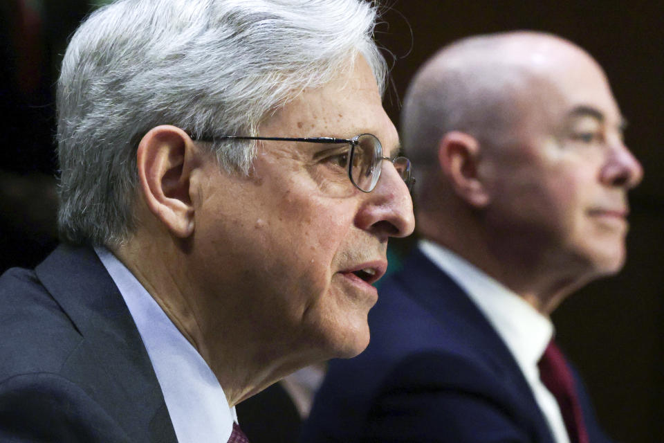 Attorney General Merrick Garland, left, and Homeland Security Secretary Alejandro Mayorkas, testify before the Senate Appropriations committee hearing to examine domestic extremism, Wednesday, May 12, 2021 on Capitol Hill in Washington. (Alex Wong/Pool via AP)
