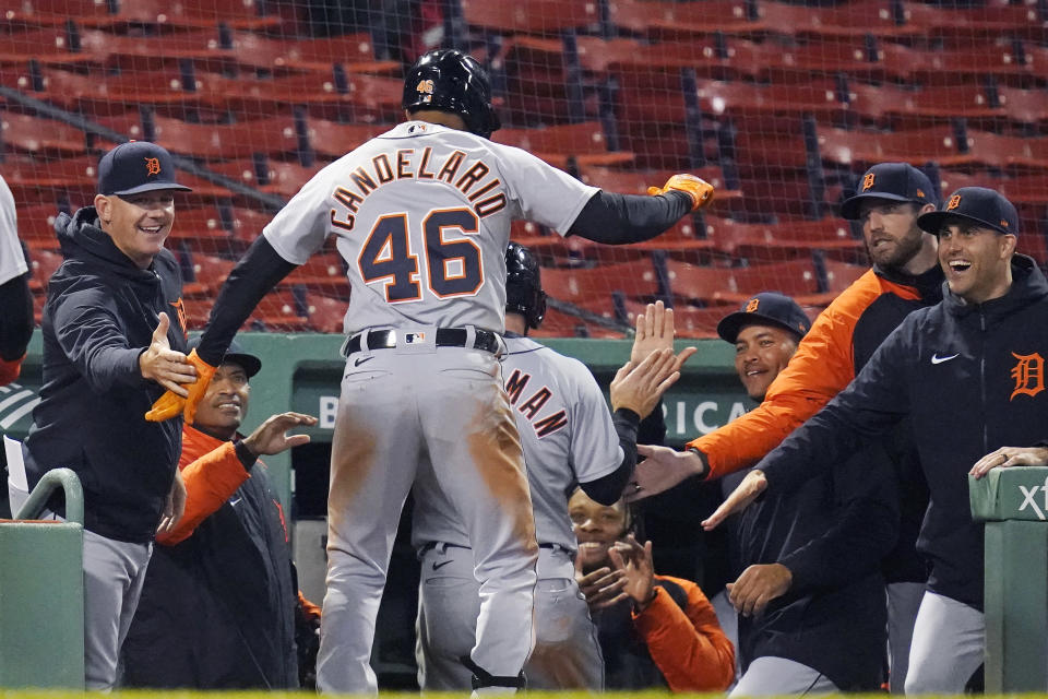 Detroit Tigers' Jeimer Candelario (46) dances on the dugout steps after his three-run home run during the 10th inning of the team's baseball game against the Boston Red Sox at Fenway Park, Wednesday, May 5, 2021, in Boston. (AP Photo/Charles Krupa)