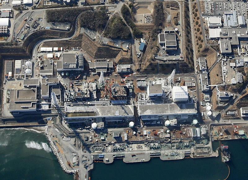 FILE - This aerial file photo taken on March 11, 2013, shows reactor buildings Unit 1 to 4, from right in the middle of the photo, at the tsunami-ravaged Fukushima Dai-ichi nuclear power plant in Okuma, Fukushima Prefecture, northeastern Japan. Four fuel storage pools at Japan's tsunami-damaged nuclear plant have been without fresh cooling water for more than 15 hours due to a power outage. The plant's operator said Tuesday morning, March 19, 2013 it was trying to repair a broken switchboard that might the cause of the problem. (AP Photo/Kyodo News, File) JAPAN OUT, MANDATORY CREDIT, NO LICENSING IN CHINA, HONG KONG, JAPAN, SOUTH KOREA AND FRANCE