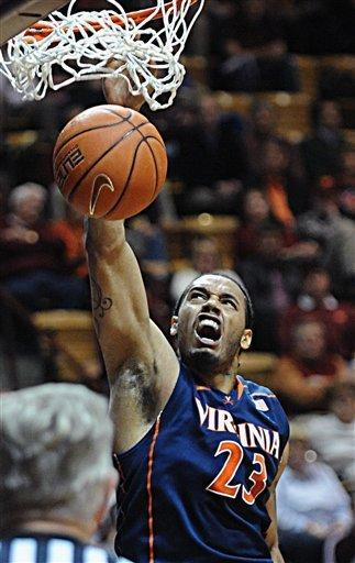 Virginia's Mike Scott dunks against Virginia Tech during the first half of an NCAA college basketball game Tuesday, Feb. 21, 2012, at Cassell Coliseum in Blacksburg, Va. (AP Photo/Don Petersen)