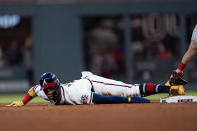 Atlanta Braves' Ronald Acuna Jr. steals second base in the sixth inning of the team's baseball game against the St. Louis Cardinals on Thursday, June 17, 2021, in Atlanta. (AP Photo/John Bazemore)