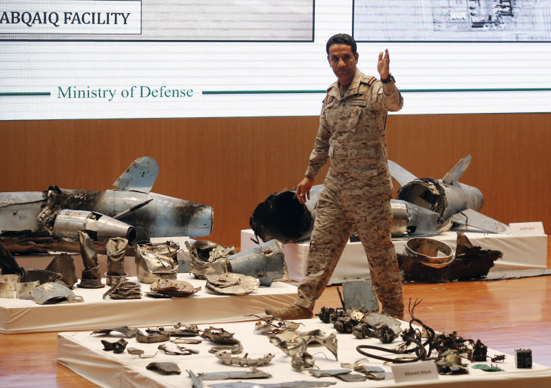Saudi military spokesman Col. Turki al-Malki displays what he describes as an Iranian cruise missile and drones used in an attack this weekend that targeted the heart of Saudi Arabia's oil industry, during a press conference in Riyadh, Saudi Arabia, Wednesday, Sept. 18, 2019. (AP Photo/Amr Nabil)