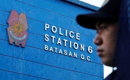 A policeman waits for the start of a flag-raising ceremony at the grounds of Station 6, Batasan Police Station, in Quezon City, Metro Manila, Philippines December 4, 2017. Picture taken December 4, 2017. To match Special Report PHILIPPINES-DRUGS/SQUAD REUTERS/Erik De Castro
