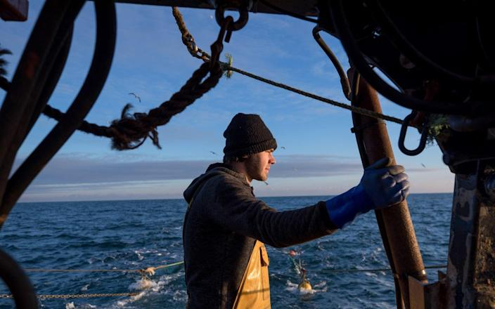 A fisherman looks out to sea aboard fishing boat 'About Time' while trawling in the English Channel from the Port of Newhaven, East Sussex, U.K. on Sunday, Jan. 10, 2021. While Prime Minister Boris Johnson claimed last month's trade deal will let the U.K. regain control of its fishing waters by taking back 25% of the European Union's rights over five years, many fishermen feel let down. Photographer: Jason Alden/Bloomberg - Jason Alden/Bloomberg