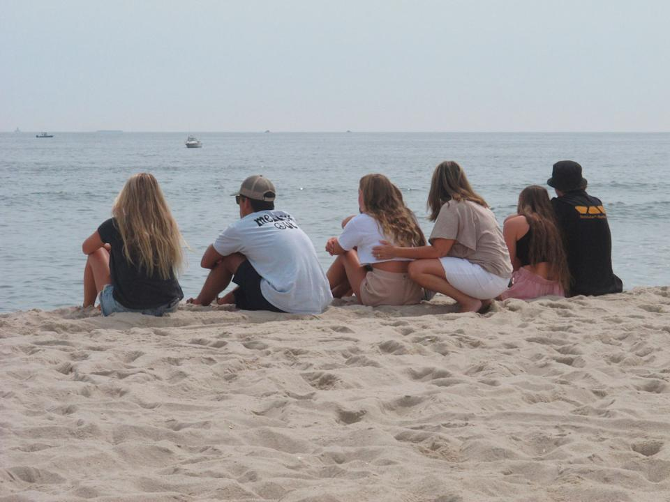 Friends of Keith Pinto gather at the beach.
